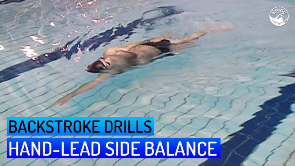 A novice swimmer who practices the hand-lead side balance drill for the backstroke.