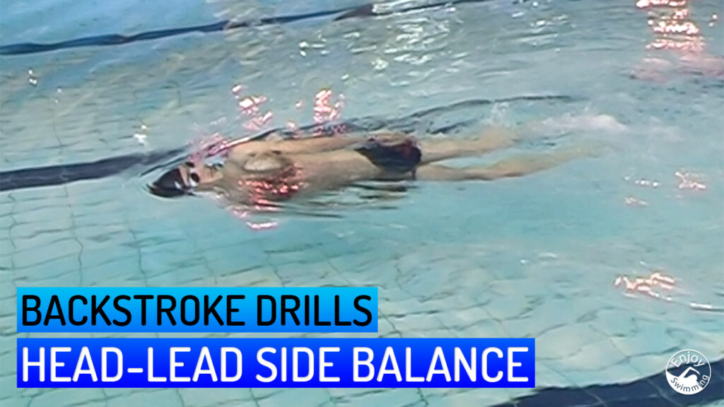 A novice swimmer who practices the head-lead side balance drill for the backstroke.