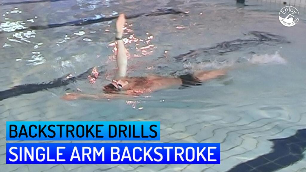 A novice swimmer practicing a single arm backstroke drill