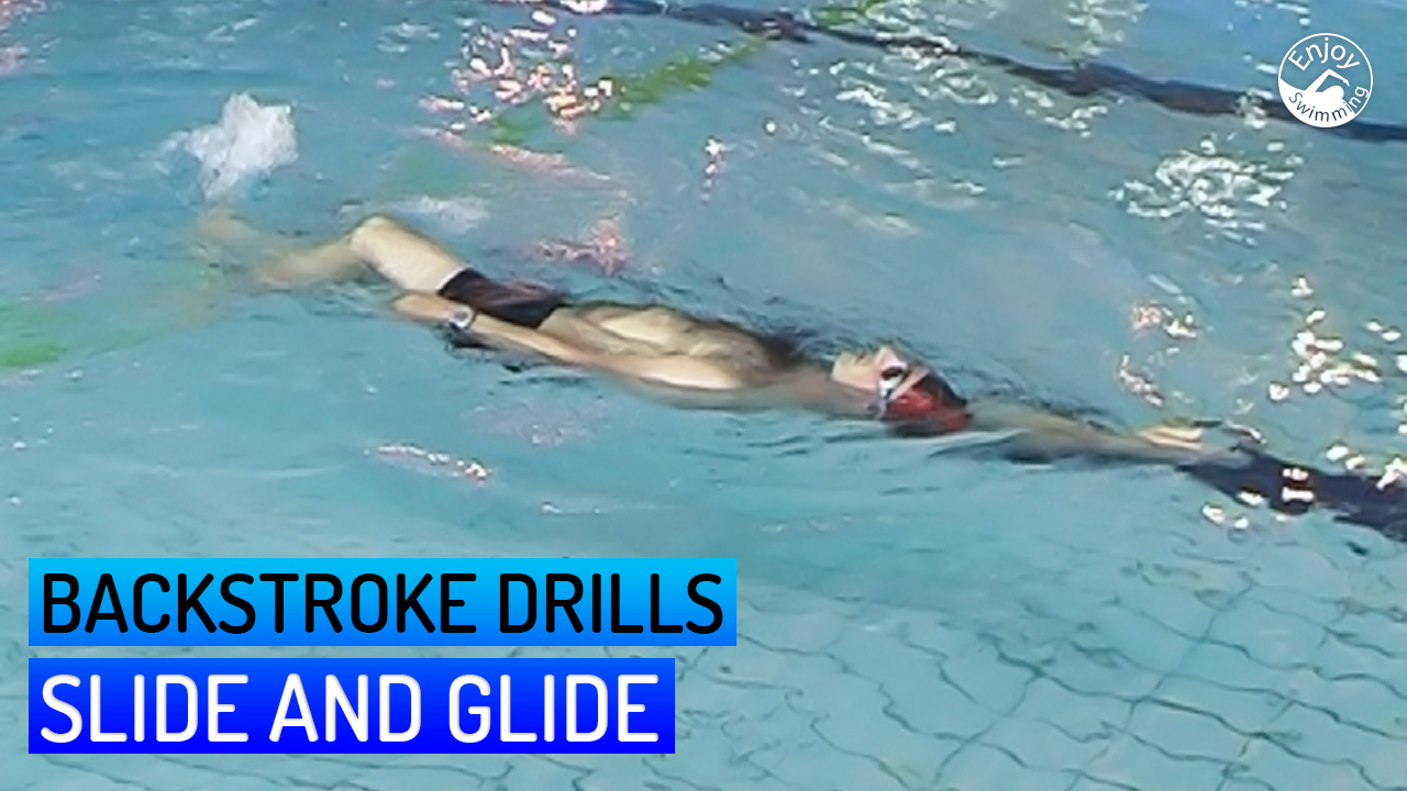 A novice swimmer practicing a slide and glide drill for the backstroke