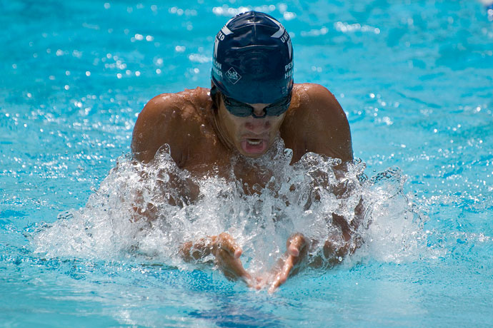 A breaststroke swimmer breathing in during the arm recovery.