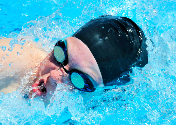 Close-up of a female swimmer breathing in the front crawl