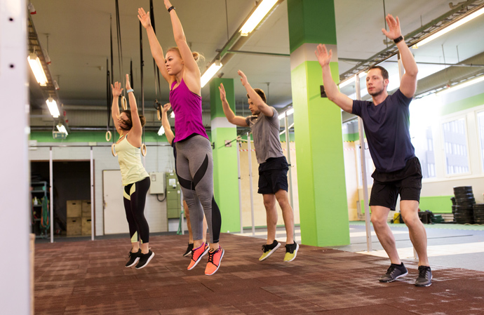 A fitness class doing burpees