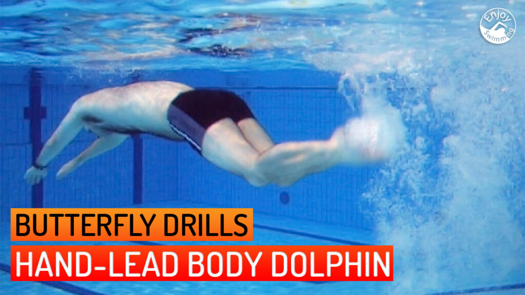 A novice swimmer who practices the hand-lead body dolphin drill for the butterfly stroke