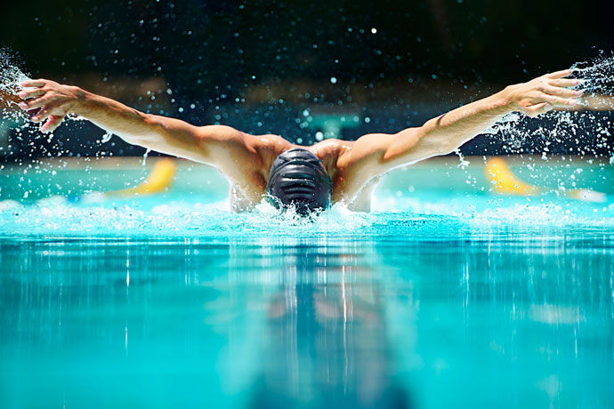 Amazing view of a butterfly stroke swimmer during the arm recovery phase.