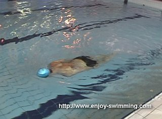 A swimmer practicing a the head-lead prone balance drill