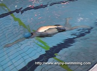 A swimmer practicing a the hand-lead nose up / nose down drill