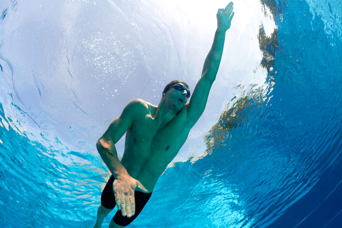 A front crawl swimmer seen from below
