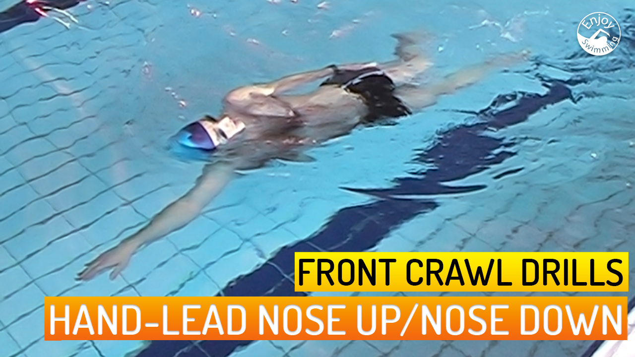 A novice swimmer who practices the head-lead nose up / nose down  drill for the front crawl stroke.