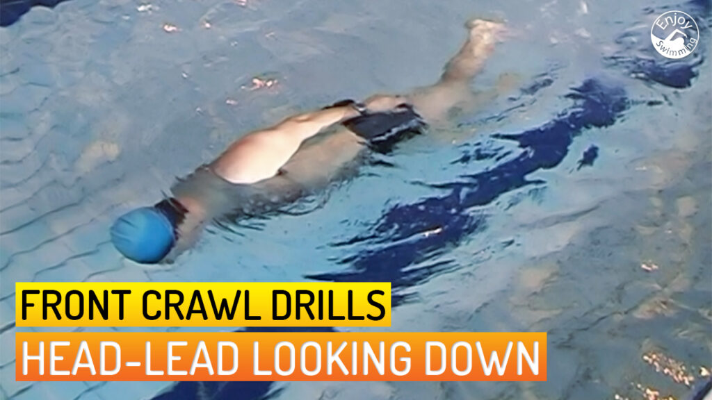 A novice swimmer who practices the head-lead looking down drill for the front crawl stroke.