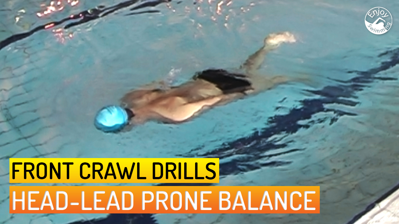 A novice swimmer who practices the head-lead prone balance drill for the front crawl stroke.