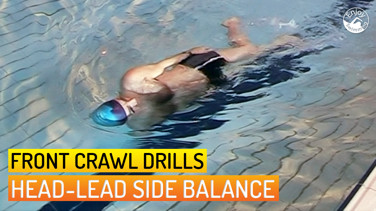 A novice swimmer who practices the head-lead side balance drill for the front crawl stroke.