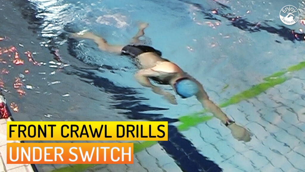 A novice swimmer who practices the under switch drill for the front crawl stroke.