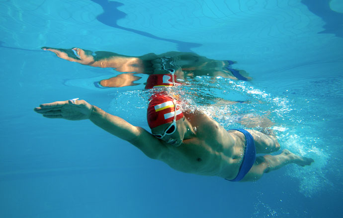 A front crawl swimmer, shot from underwater