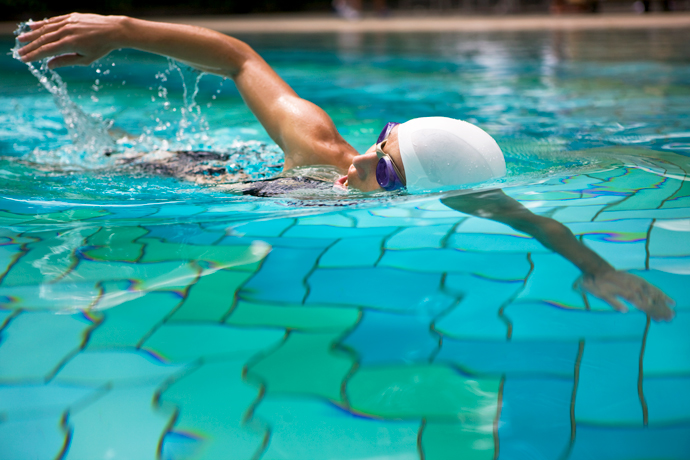 A young woman breathing on her side while swimming the front crawl.