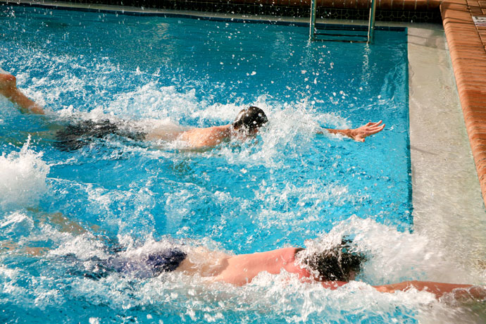 Two men engaged in a front crawl race