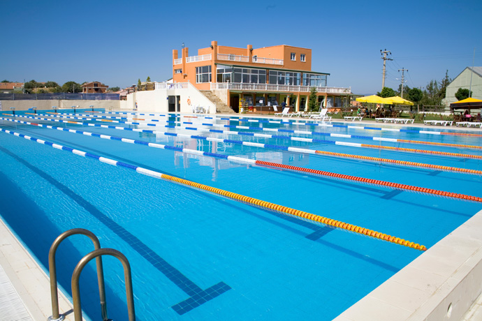 Beautiful sunny view of an outdoor swimming facility.