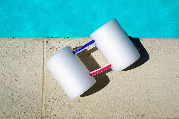 A pull buoy lying at the poolside