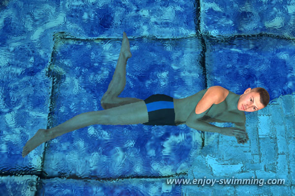 A sidestroke swimmer floating in the water
