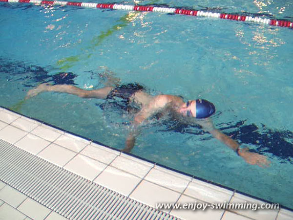 A man swimming sidestroke