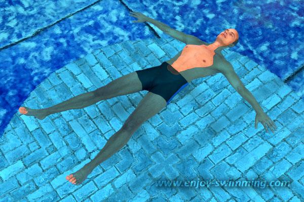 Un homme dans une piscine flottant à l'horizontale en étoile de mer