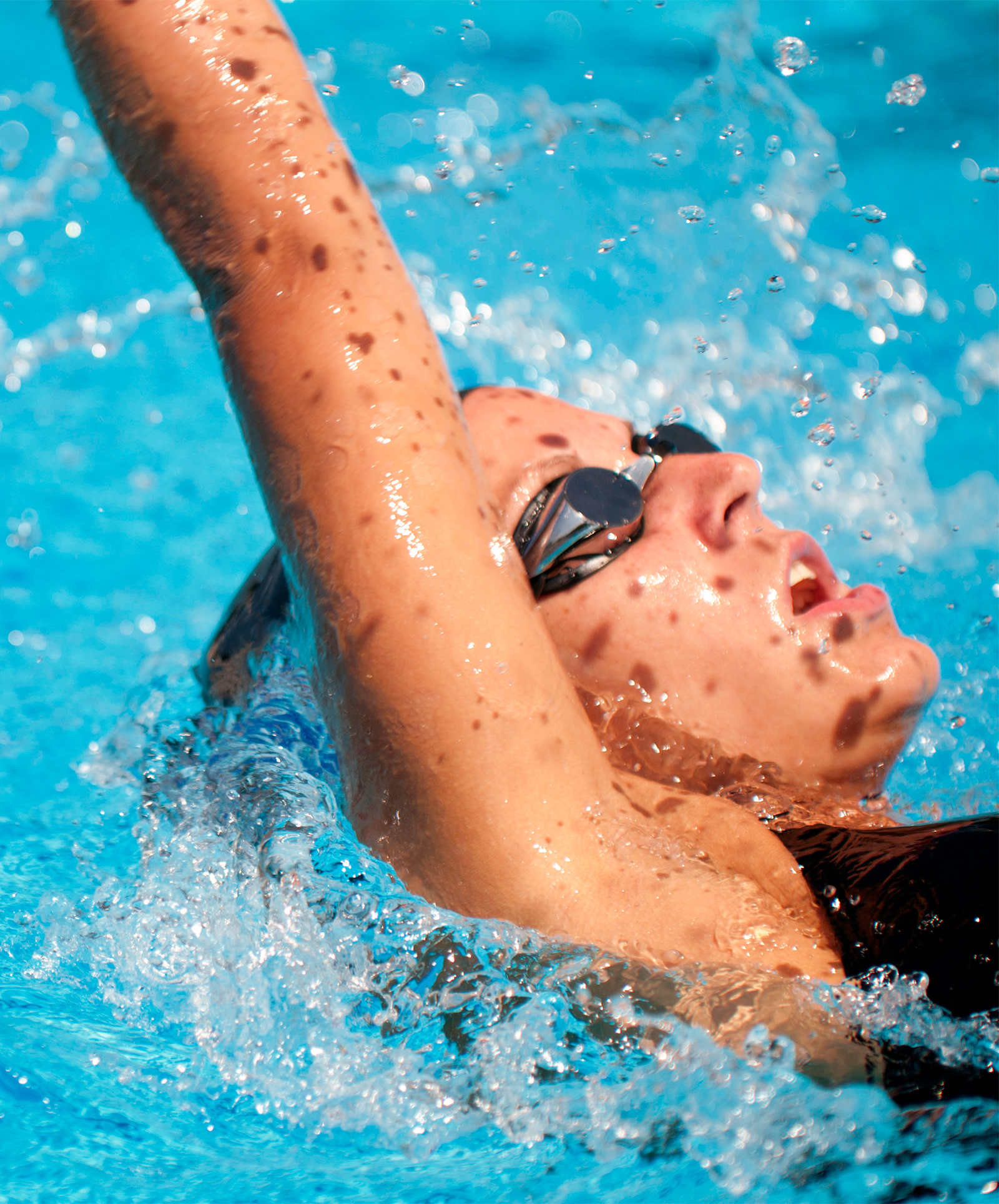 Breathing in backstroke poses a few challenges.