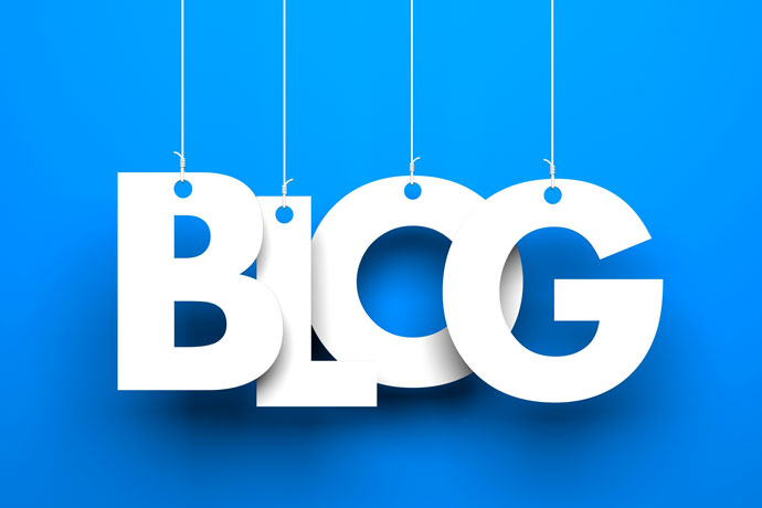 "Cut out white letters of the word ""blog"" on a blue background"