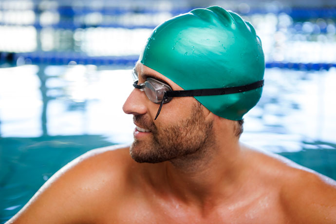 Man wearing a silicone swim cap
