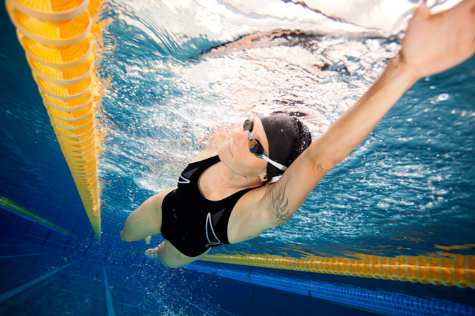 A female freestyle swimmer shot from under water