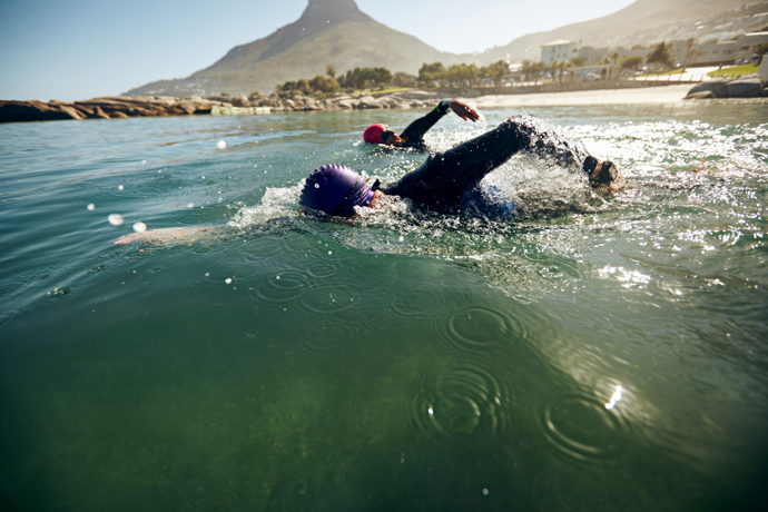 triathletes training in a lake